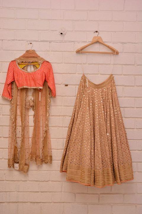 Gold & beige lehenga with coral blouse and scalloped dupatta - Abhinav Mishra - Best Shahpur Jat boutique designer for bridal wear