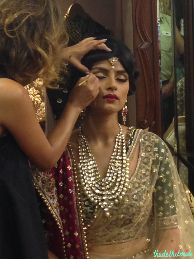 Gold eyeshadow with thick eyeliner and red pout - bridal makeup - Vidya Tikari at Sue Mue store visit