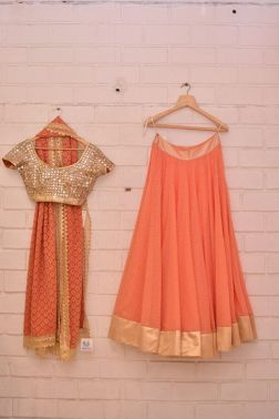 Gold heavy sequin blouse and peachy orange lehenga