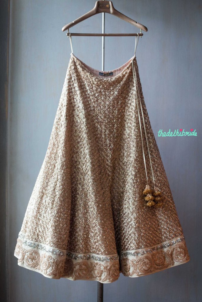 Heavily embroiderd Ivory lehenga with heavy gold work details - New JADE M&K Couture Studio - Mumbai Review