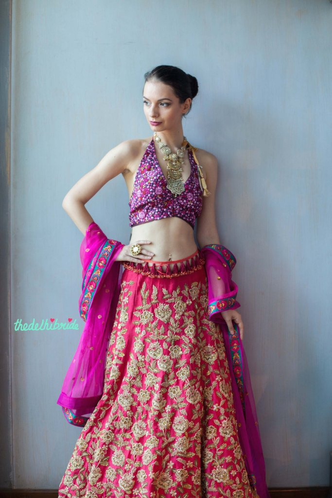 Heavily embroidered purple halter blouse and pink embroidered lehenga - New JADE M&K Couture Studio - Mumbai Review