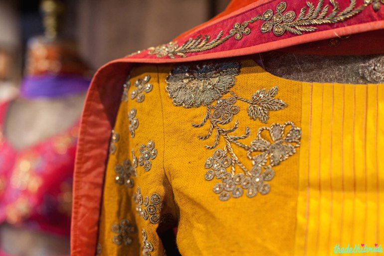 Intricate embroidery on yellow kurta details - New JADE M&K Couture Studio - Mumbai Review