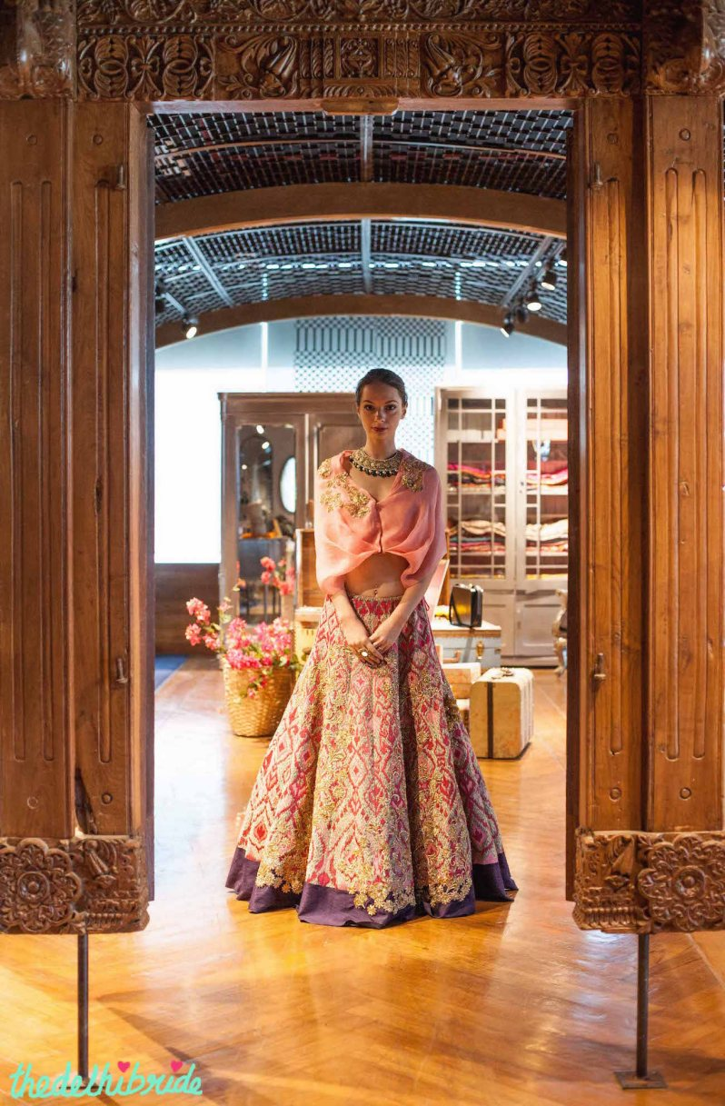 Pale pink cape blouse with heavily embroidered pink purple & gold lehenga - New JADE M&K Couture Studio - Mumbai Review