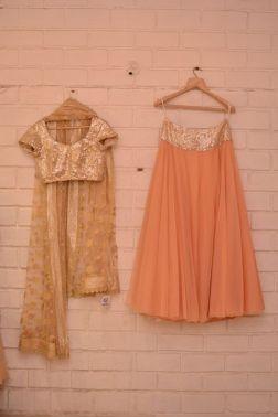 Peach light lehenga with heavy sequin gold blouse