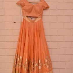 Peachy orange lehenga choli