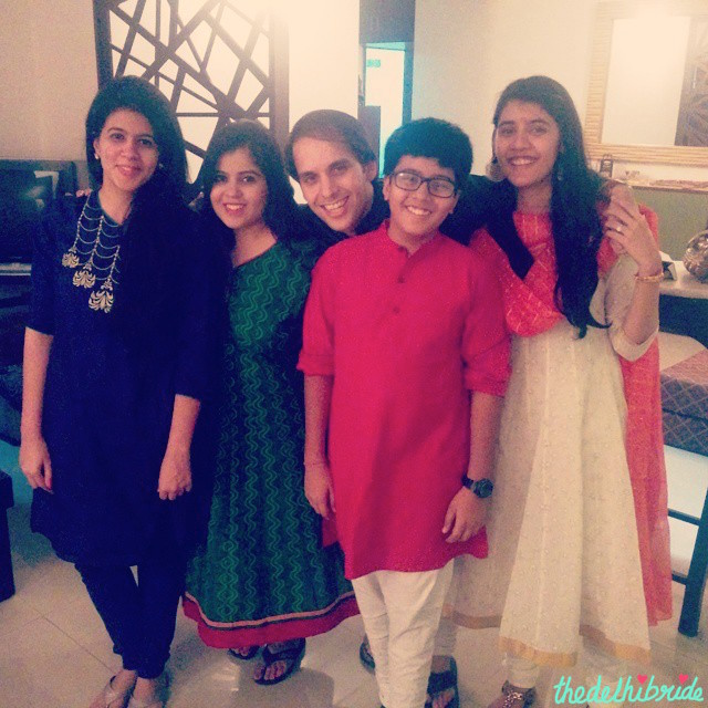 That's me on the right in my white and gold anarkali with red dupatta - all from FabIndia! Wore it on Diwali