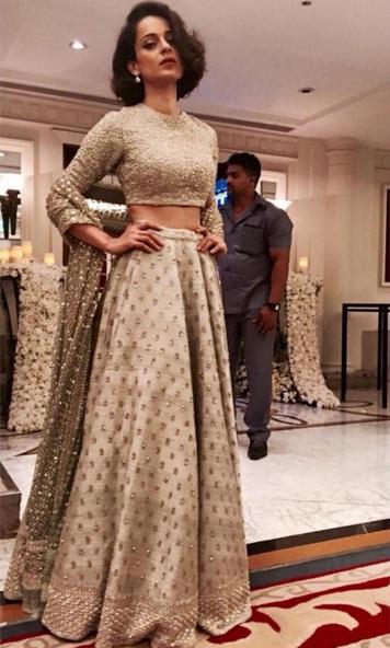 Wedding guest style - Sangeet - Kangana Ranaut in an Ivory embellished Sabyasachi lehenga - Masaba Gupta and Madhu Mantena Wedding 2015