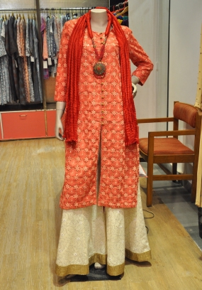 Oomph Factory - Orange kurta with sharara - Meherchand market wedding shopping guide