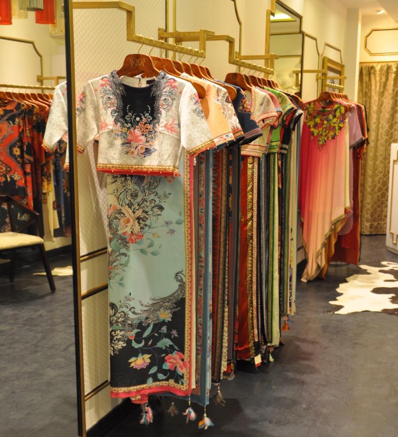Rajdeep Ranawat - Rack of digital print saris - Meherchand market wedding shopping guide