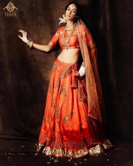 Tisha Saksena - Embroidered orange lehenga set - Meherchand market wedding shopping guide