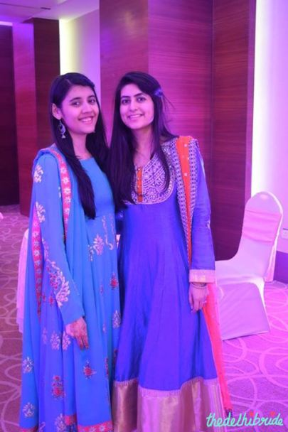 That's me on the left in my turquoise blue anarkali