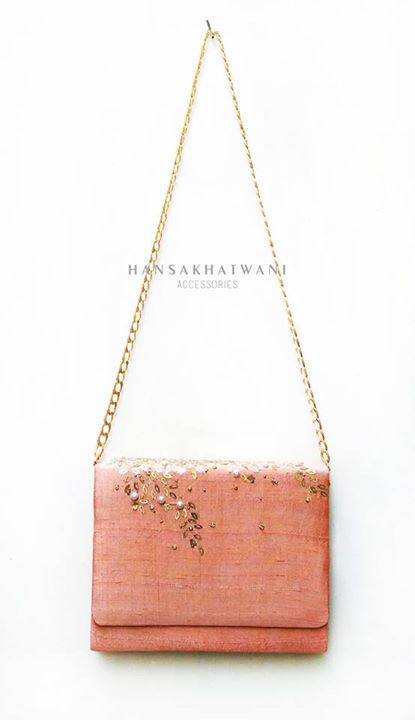 Bags for bride's trousseau - Coral sling bag with hint of gold & pearl embroidery by Hansa Khatwani