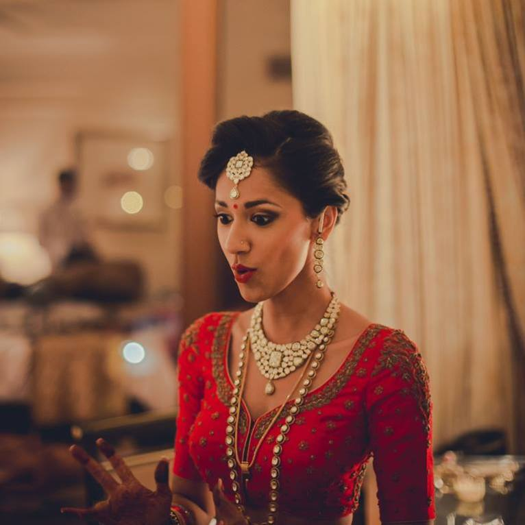 Reception - Getting ready 2 - embroidered red bridal blouse - Anasuya Wedding Wardrobe