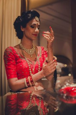 Reception - getting ready - embroidered red bridal blouse - Anasuya Wedding Wardrobe