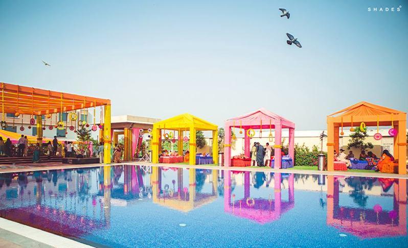 Rhea and Rishabh - Colourful lounge decor idea for poolside Mehendi ceremony