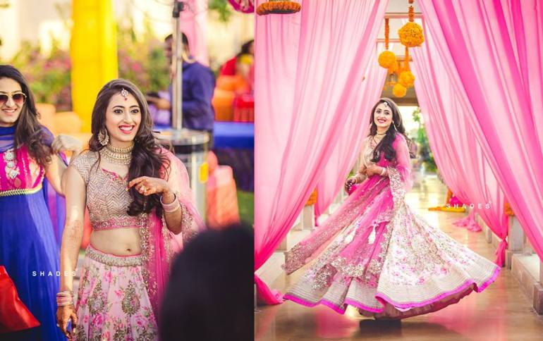 Rhea and Rishabh - pink floral lehenga by Anushree Reddy - bride's Mehendi outfit