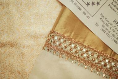 Wedding - Malyali bride cream & gold sari from Kerala - Anasuya Wedding Wardrobe