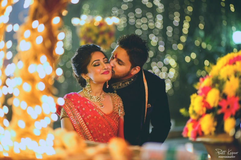 Wedding Wardrobe Apoorva - pink & gold Frontier Raas bride with her husband Pulkit