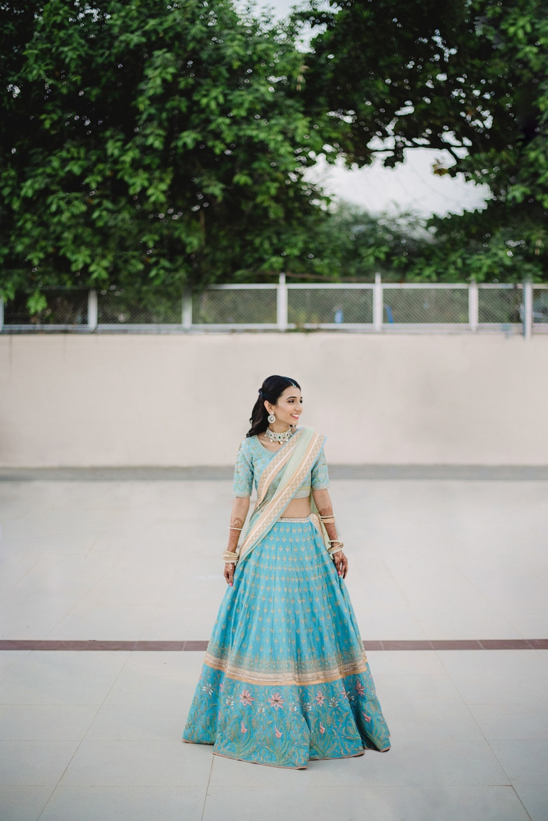 Wedding Wardrobe Masoom Minawala - Anita Dongre bride in blue gota patti lehenga - bridal portrait