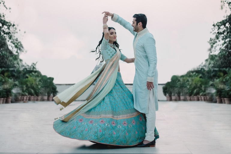 Wedding Wardrobe Masoom Minawala - Anita Dongre bride in blue gota patti lehenga - twirling with Shailin at her Roka