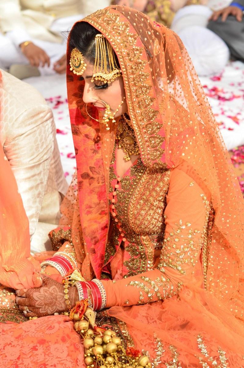 Wedding Wardrobe Shirin - Orange & Gold Sabyasachi bride with paasa & nath