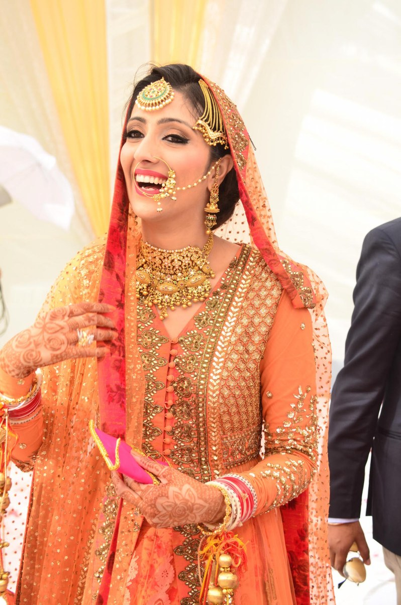 Wedding Wardrobe Shirin - Orange & Gold Sabyasachi jacket lehenga front detailing