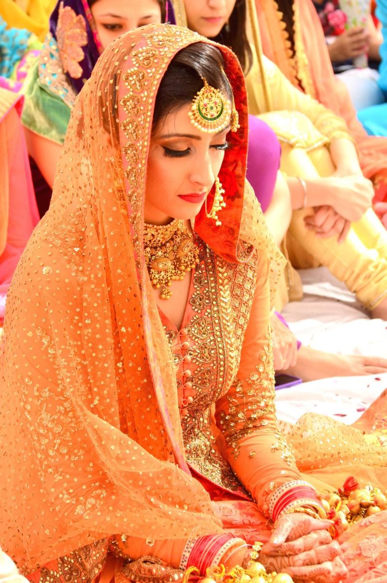 Wedding Wardrobe Shirin - Orange & Gold Sabyasachi jacket lehenga