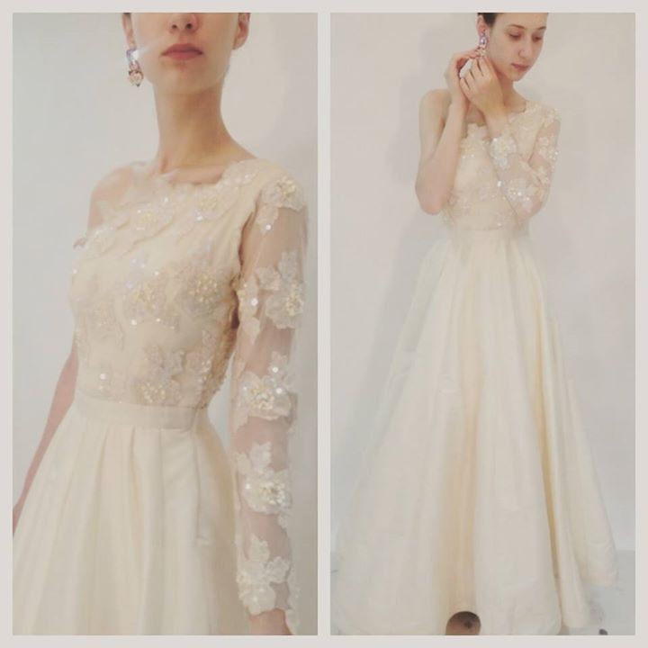 White wedding gown by Nitya Bajaj - one shoulder ivory gown with subtle embroidery