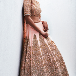 Heavily embroidered peach bridal lehenga