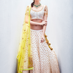 Ivory lehenga with yellow dupatta