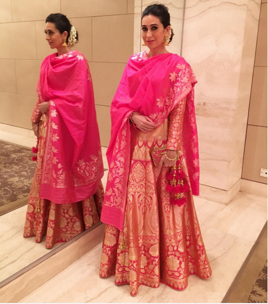 Karishma Kapoor in a rani pink silk lehenga by Neerua clothing - Bollywood - Celebrity fashion 2016