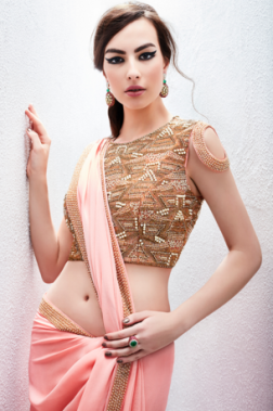 Peach sari with heavily embroidered lehenga