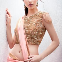 Peach sari with heavily embroidered lehenga