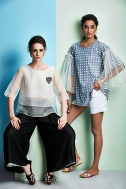 White layered top with black wide pants | Blue checked top with bell sleeves and shorts
