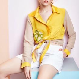 Yellow shirt with white shorts