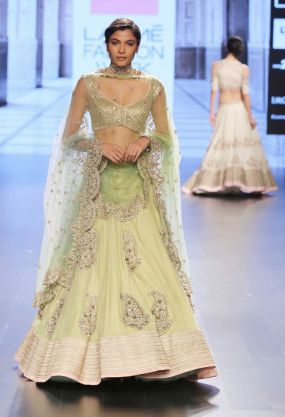 Light green lehenga with silver choli and scalloped dupatta by Anushree Reddy at Lakme Fashion Week Summer Resort 2016