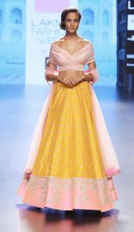 Pastel pink off-shoulder blouse with sunshine yellow and pink border lehenga by Anushree Reddy at Lakme Fashion Week Summer Resort 2016