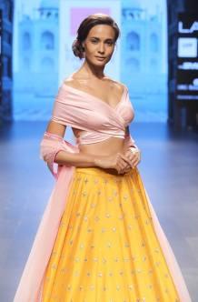 Pastel pink off-shoulder blouse with sunshine yellow lehenga and pink dupatta by Anushree Reddy at Lakme Fashion Week Summer Resort 2016