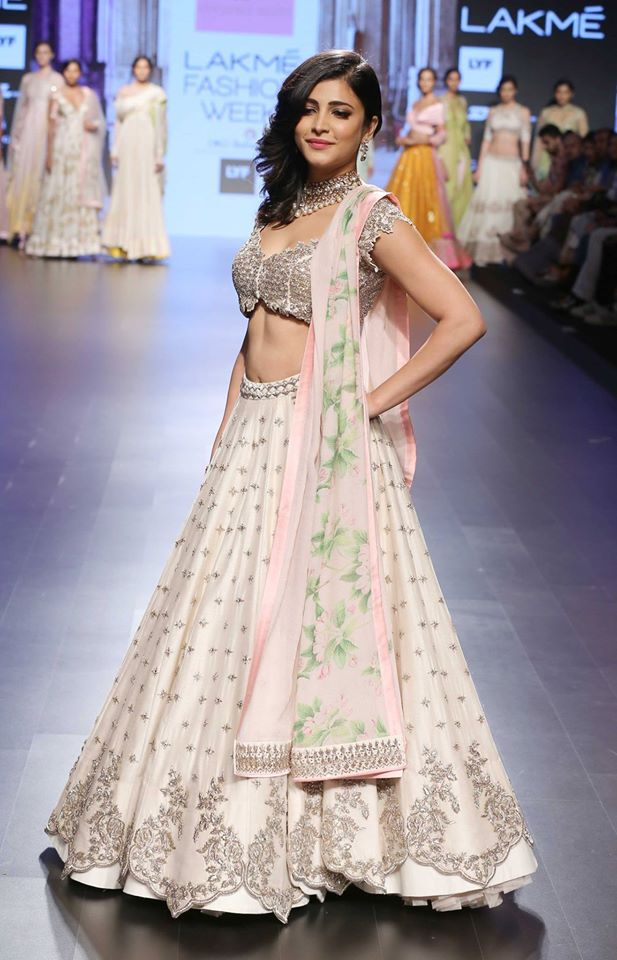 Shruti Hasan in ivory lehenga with scalloped handmade zardozi and floral pastel lily print dupatta by Anushree Reddy at Lakme Fashion Week Summer Resort 2016 side view