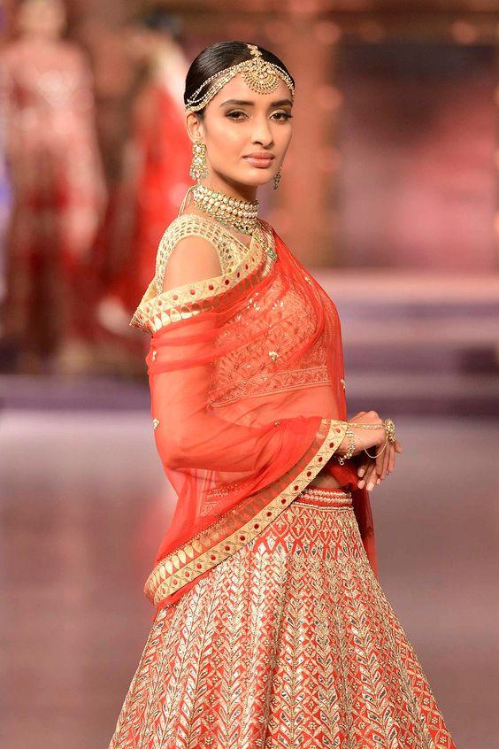 Heavily embroidered red gota patti and zardosi raw silk lehenga and choli - side - Anita Dongre - Make in India 2016